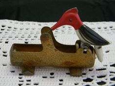 Vintage cast iron woodpecker toothpick holder.