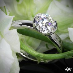 """Beyond beautiful, the """"True Love"""" Solitaire Engagement Ring combines simplicity with pure grace. The half-bezel design ensures that your diamond gets the attention it deserves and the security it needs."""