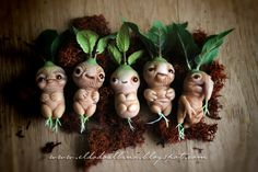 A little spooky but I like how the leaves grow out of the heads. LOL OOAK Mandrake art doll. by dodoalbino