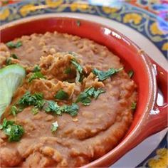 Quick and Easy Refried Beans - Allrecipes.com.  * * I use grapeseed or olive oil & sometimes add minced white onions. * * ( I prefer to soak/cook dried beans - but this is a quick version.)