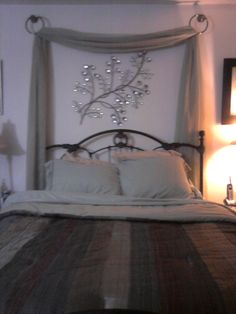 Love the drape behind the bed                                                                                                                                                                                 More