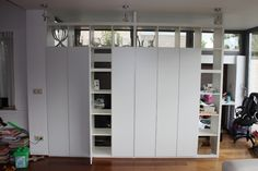 IKEA Hackers: Closed Expedit wall    Our little house might be too small to do this in, but it's a cool idea.