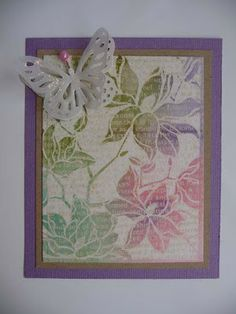 1 - Emboss the flower stamp with ink and clear embossing powder. 2 - Repeat the same operation with the text buffer (buffer overlay alread ...