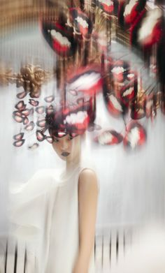 Modeconnect.com - Fashion Photography by Nick Knight, featuring a hat by Philip Treacy SS03 and dress by Chalayan SS99