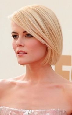 Sleek chin length bob cut. Cut just below the chin and kept straight and neat. Bangs swept to the side.