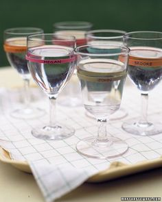A guest's wineglass won't end up in the wrong hands when one of these brightly colored name tags identifies it. Use a permanent marker to write the name of a guest on a wide rubber band after placing it around a glass. Alternatively, you might use the bands as napkin rings that double as place cards.