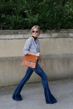 Flared jeans lend themselves well to this Parisian-inspired outfit on Lucy of Fashion Me Now. Get the look with a skinny scarf tied around your neck and a Breton striped top. Fashion Me Now, Fashion Week, Passion For Fashion, Womens Fashion, Fashion Trends, Style Désinvolte Chic, Look Chic, Style Me, Classic Style