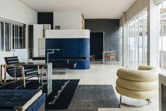 Villa E-1027's sunlit living room offers a glimpse at designer Eileen Gray's furniture.