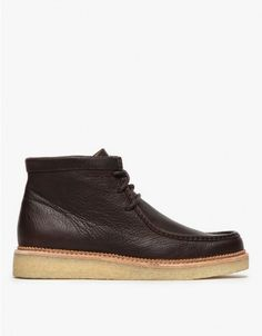 From Clarks, a classic Wallabee inspired leather ankle Beckery Hike boot in Dark Brown.  Features moccasin-style lace up, round toe, double stitch leather welt detail,  platform wedge, leather uppers, leather ankle lining and tongue and crepe sole.  •L