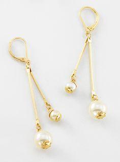 d0aca57c677a Aretes con 4 baños de oro de 18 kilates y perlas.