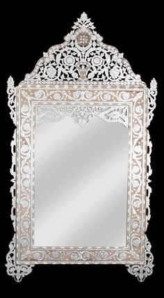A beautiful mother of pearl mirror hand made in Damascus by Nevine Zaim