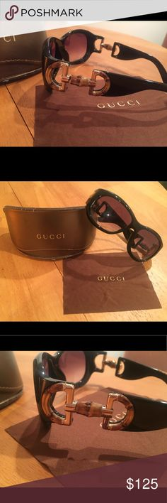 Gucci Sunglasses Black Bamboo Horsebit Gorgeous!  NWOT never worn received as a gift.  Genuine Gucci black sunglasses with bamboo horsebit logo on temples.  Comes with matching logo case and cloth.  Style GG 2970/s Size 57-14 Gucci Accessories Sunglasses
