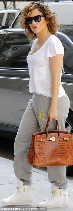 Fancy: The star dressed up her casual look with an embossed Hermes handbag