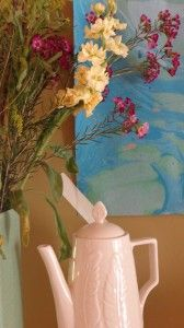 My mantel for Fiona's party. Fresh flowers,odd color mix, shiny happy shaped teapot. bywstudent