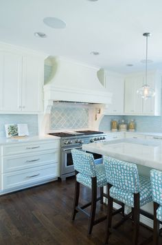 white kitchen with blue accents | Profile Cabinet and Design