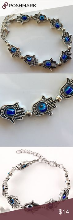 """Silver Lucky Hamsa Blue Stone Evil Eye Bracelet Beautiful bracelet!  Each vintage antique silver hand is ordained with a floating, spinning blue faux stone evil eye.  Hands measure just over 1/2"""" long.  This boho bracelet measures 6 3/4"""" long, and has an additional 2"""" extender chain.  Brand new in manufacturer packaging.  We typically ship daily.... Sometimes twice! (A) Jewelry Bracelets"""
