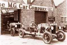 Morris Garage?  The M.G. Car company  I have not seen the periods in the MG name before.