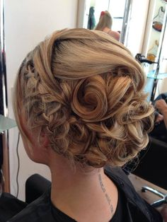 Wedding hair, integrated plaits with barrel curls.