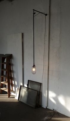 I'm definitely going to make a light like this for a space in my bachelor pad some day.