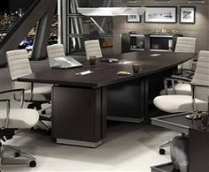 Professional boardroom with Global Total Office Zira series boat shaped table and Accord series white leather office chairs.