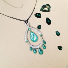 Work in progress... playing with green beryls and tourmalines for this pendant.