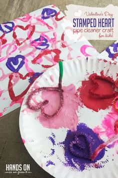Create lovely stamped heart artwork with DIY pipe cleaner stamps! Dip them into Valentine's Day-theme colored paint to make your own patterns.