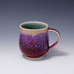 Wheel-thrown Porcelain Mug with Purple red and Light Tan Blue speckles by Hsinchuen Lin