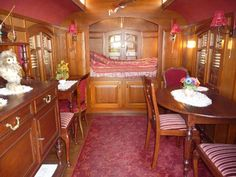 http://www.roulottes.nl/ Company makes 'gypsy wagons', France. This is a small one room, owner made kitchen/bathroom separate.