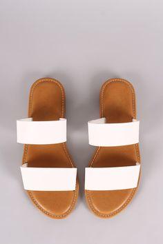 b0a68e3d65044e This slide sandal features an open toe silhouette