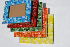 5 x 7 monochromatic mosaic picture frame. You choose the color! Choose from Red, Orange, Yellow, Green, Blue, Purple, Pink, Black, Gray, or White! Makes a fantastic gift! Please choose your color at checkout. Each 5 x 7 mosaic picture frame is handcrafted so no two will be exactly alike. Overall dimensions are 8 x 3/16 x 10 1/4 x 1/2 Fits a 5 x 7 photograph  DETAILS: * Made for either a horizontal or vertical photograph * Has an easel on the back for tabletop display * Solid wo...