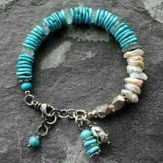 Sleeping Beauty Turquoise and Keishi Pearl Handcrafted Sterling Silver Bracelet. Love the concept of the dangley's by the lobster clasp. Turquoise Jewelry, Boho Jewelry, Jewelry Crafts, Beaded Jewelry, Jewelery, Jewelry Bracelets, Jewelry Design, Necklaces, Artisan Jewelry