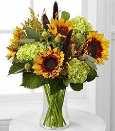 Pretty fall arrangement with Sunflowers and Hydrangeas.