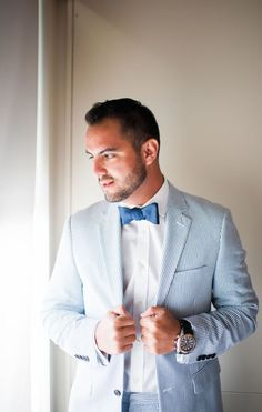 Groom in a seersucker suit and navy blue bow tie. Love it!    Nautical Blue and White Florida Keys Wedding // Faro Blanco Resort and Yacht Club | Ashlee Nicole Photography