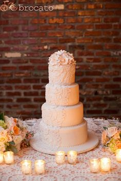 Beautiful ivory lace wedding cake by SSL.