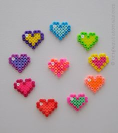 Tip: Papers I usually buy on Ebay or Origami Shop. Japanese books I tend to buy from CDJapan. As you can see, it's a very simple bead design – which only requires a few colored beads and your rectangular/square pinboard. You can use your bead hearts like this for magnets or as a keychain ornament. …