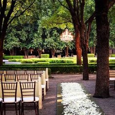 Weddings by StarDust Sneak Peek: Katelyn and Kyle Ceremony & Reception: Marie Gabrielle Restaurant & Gardens Beautiful outdoor ceremony under a chandelier with rose petal aisle and vintage church pews.