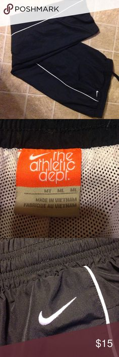 Nike track pants. Sz MT. Nike track pants. Sz MT.  100% polyester. Mesh lining. One back pocket with snap. Elastic / drawstring waist. Nike Pants Track Pants & Joggers