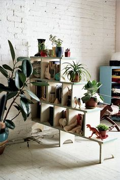 Or use a staggered bookcase system for a more airy feel.
