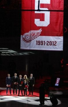 Former Detroit Red Wing Nick Lidstrom with his family wife Annika and sons Kevin, Adam, Samuel and Lucas watch as Lidstrom's number 5 is raised to the rafters of Joe Louis Arena in Detroit, Thursday, March 6, 2014. Diane Weiss/Detroit Free Press