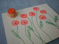 mini poppy hand carved stamp, hand carved rubber stamp, handmade rubber stamp. $4.00, via Etsy.