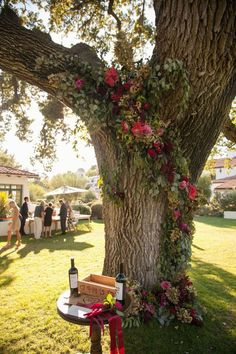 Tree Adorned with Garlands of Greenery & Florals | Photography: Christine Chang / All You Need is Love Events. Read More: http://www.insideweddings.com/news/planning-design/marsala-wedding-ideas-inspired-by-pantones-color-of-the-year/2023/