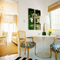 Banquette and Small Space Dining ~ Iconic Saarinen tulip table paired with traditional Louis XIV chairs