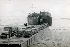 Tarakan LST 993 unloading on a pontoon causeway 1945  USS LST-993 was an LST-542-class tank landing ship in the United States Navy. Like many of her class she was not named and is properly referred to by her hull designation.LST-993 was laid down on 7 March 1944 at the Boston Navy Yard; launched on 7 April 1944; sponsored by Mrs. Gladys L. Morey; and commissioned on 12 May 1944 Lt. A. W. Bates USNR in command.
