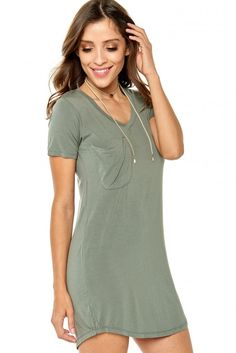 1447a79e011 Silky smooth sleek jersey fabric shapes a cool and casual shirt dress with  a V-neckline