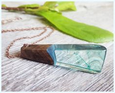 Shard of Ocean resin and wood pendant necklace, antiqued brass chain.  #designer #jewelry #resin