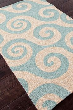 """Wave Hello"" rug from the Coastal Living collection of indoor-outdoor rugs by Jaipur. (also available in dark blue)"