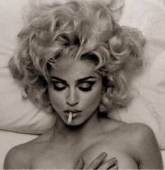 """""""I'm tough, ambitious, and I know exactly what I want. If that makes me a bitch, okay.""""-Madonna"""