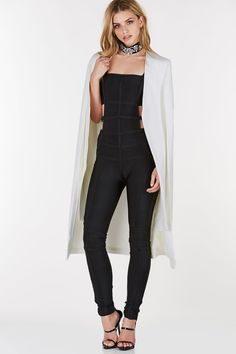 afa3266a5cc1 Bandage style jumpsuit with cut outs on each side. Slim fit with comfortable  stretch and back zip closure. Polyester-Spandex blend Imported Model is  wearing ...