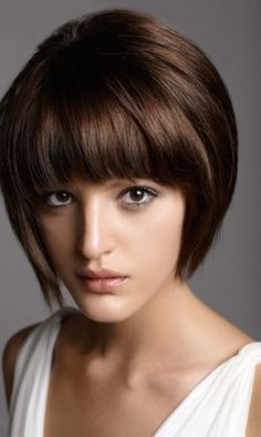 23 Cute Short Hairstyles With Bangs: #6. 60s inspired short bob with blunt bangs