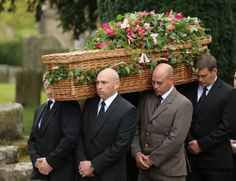 The simple wicker casket of the Dowager Duchess of  Windsor, being carried by the games keepers from Chatsworth, who were the pall bearers. The flowers were simple flowers from woodlands. This lady had style right to the end.